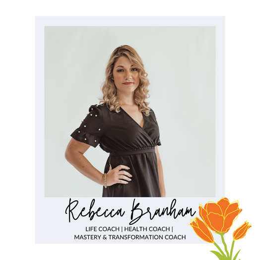 Rebecca Branham is standing with her hand on her hip